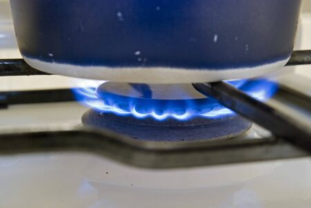 Gas hob with a pan boiling water photo