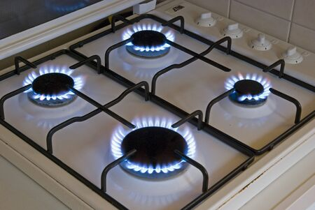 Four blue flames of a gas stove photo