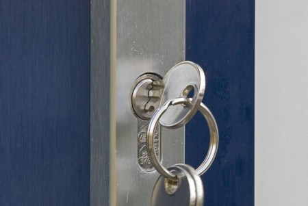 Aluminium door handle and lock with a set of house keys Stock Photo - 4038183