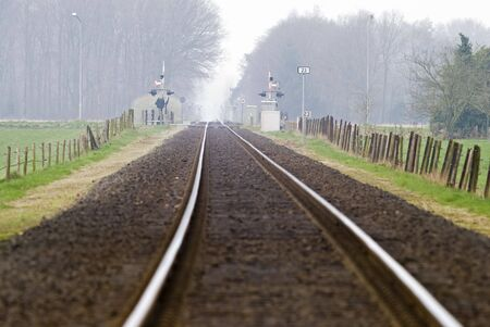railtrack: Railtrack with hazy crossing in the background. Stock Photo