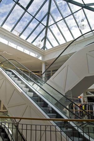 Escalator in a mall with glass roof photo