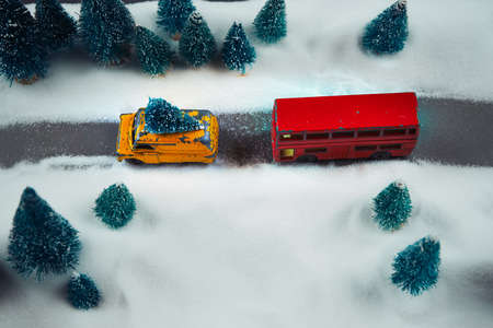 Toys car and bus background in winter forest miniature. Selective focus