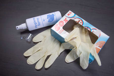 Hygiene spray and latex gloves - bottleneck, empty, used up