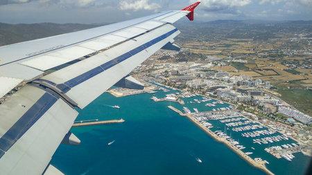 Air Berlin Airplane approaching tourist center on Ibiza