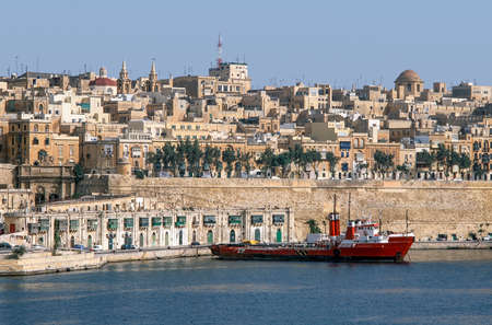 Valletta harbor with fireboat.
