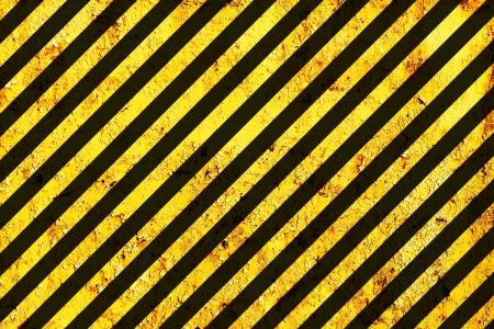 industrial safety: Grunge Black and Orange Surface as Warning or Danger Pattern, Old Metal Textured Stock Photo