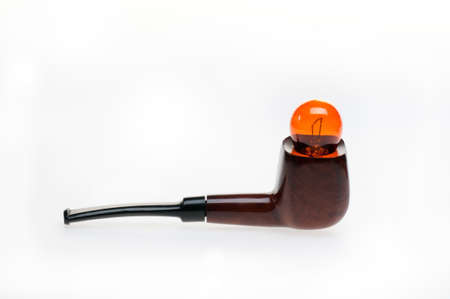 tobacco-pipe with yellow bulb on it photo