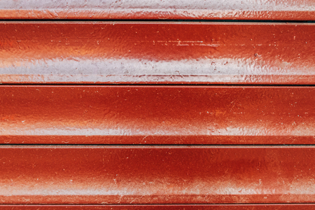 Red paint on metal blinds