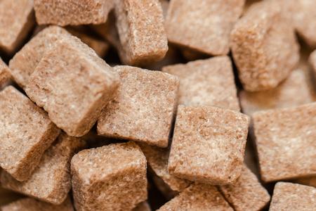 Brown sugar background. Close up