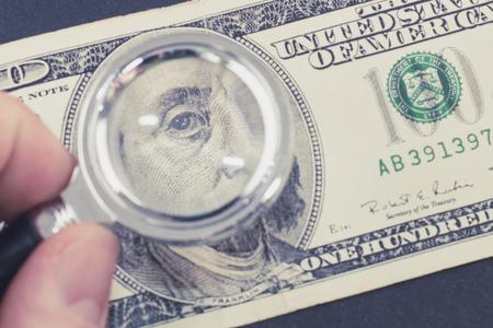 Dollar under the magnifier