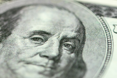 Benjamin Franklin portrait close-up on 100 dollars banknote Stock Photo