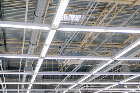Ceiling with hood, ventilation with lighting sections.