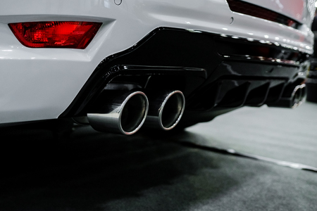 Close up of tuning white car exhaust pipe. Imagens