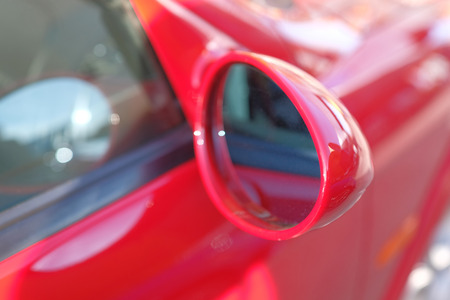 Close-up of side mirror of a red sports car. Stock Photo