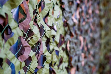 Camouflage grid on the fence Reklamní fotografie