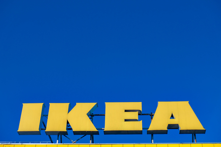 RUSSIA, ST.PETERSBURG - May 05, 2018: Logo IKEA on a shopping center on a background of blue sky Editorial