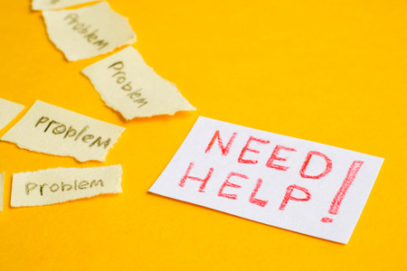 Concept cry for help in solving problems. Torn stickers with the word