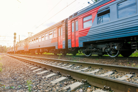 Electric train leaving in the summer time Editorial