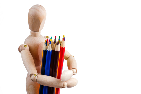 The concept of human artist. Wooden man holds color pencils on a white background.