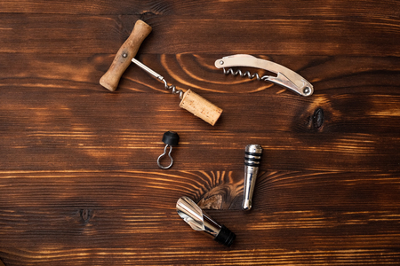 A wine accessories on wooden background. Top view. 스톡 콘텐츠