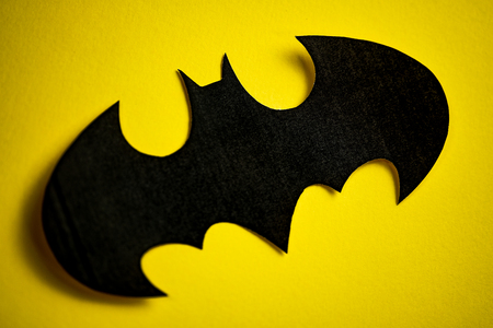 RUSSIA, ST.PETERSBURG, April 16, 2019: DC comics batman sign black logo printed on yellow background