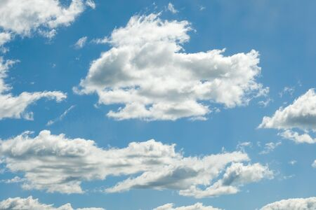 White clouds on a blue sky on a sunny summer day. Close up.