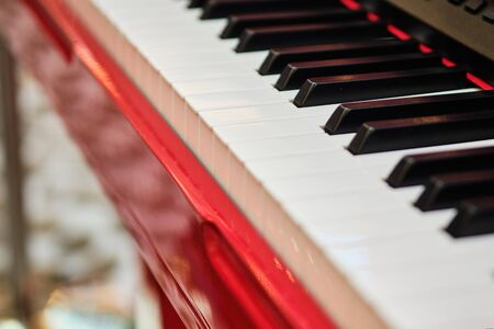 Musical instrument - piano. View from the side. Close up.