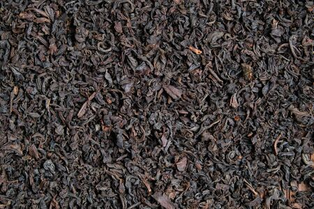 The texture and background of black tea. Top view. Close up. Stock fotó