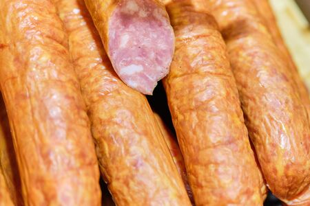 Sausage meat in the cut on the store counter. Close up.
