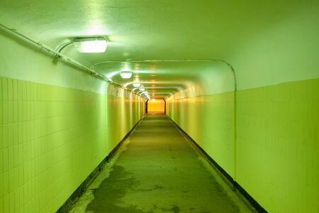 Underground pedestrian tunnel with green walls. Close up.