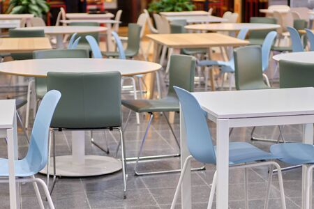 Modern tables and blue chairs in shopping malls. Close up.