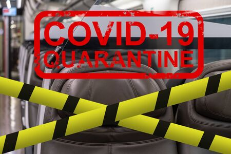 Abstract inscription - covid-19, quarantine on the background of an empty train carriage. Close up. Фото со стока