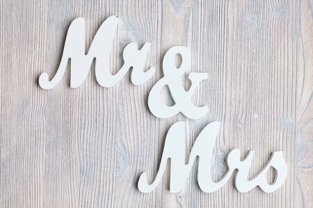 Letters mr and mrs on a wooden background. Top view. Close up. Stock fotó