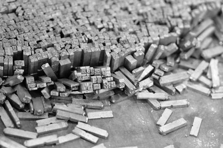 Old metal letters for printing black and white photo. Close up. Noise. Standard-Bild