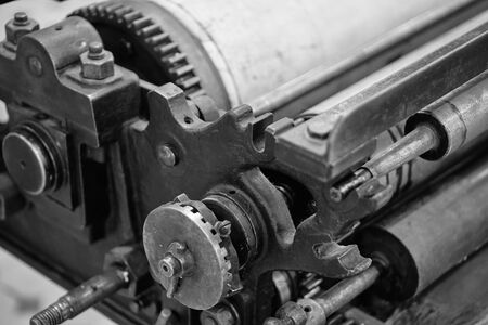 Old typography printing machine. Close up. Noise. Banco de Imagens