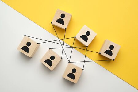 Competitions at work - abstract people on cubes with ties. Close up.