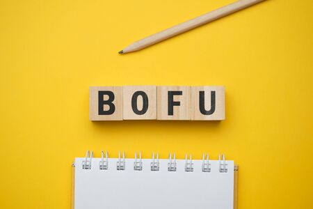 Modern marketing buzzword - BOFU Bottom of funnel. Top view on wooden table with blocks. Top view. Close up. 스톡 콘텐츠