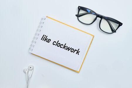 Like clockwork - english idiom hand lettering on wooden blocks. 免版税图像 - 148715373