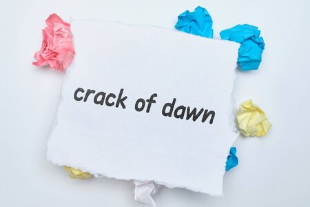 Crack of dawn - english idiom hand lettering on wooden blocks.