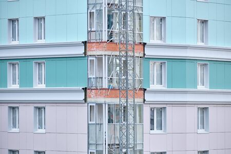 Construction of a new residential building with modern material cladding