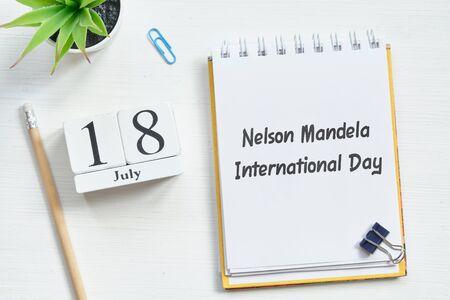 18th july eighteenth day month Nelson Mandela International Day calendar concept on wooden blocks