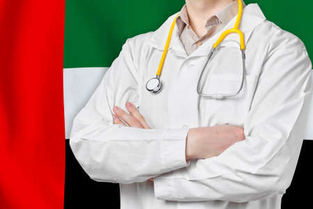 United Arab Emirates healthcare concept with doctor on flag background. Medical insurance, work or study in the country