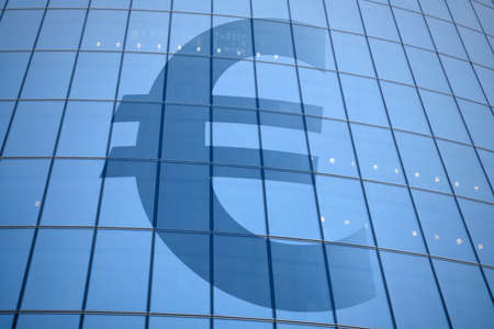 Abstract euro currency sign on the facade of a skyscraper