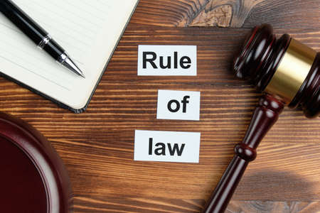 Rule of law - an inscription on wooden cubes with a number of judge hammer 写真素材
