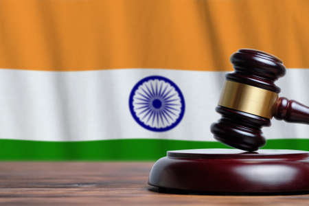 Justice and court concept in Republic of India. Judge hammer on a flag background. 写真素材