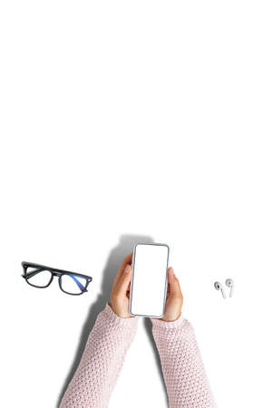 Girl use smartphone on white background with copy space 写真素材