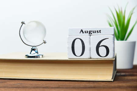 6st august - sixth day month calendar concept on wooden blocks.