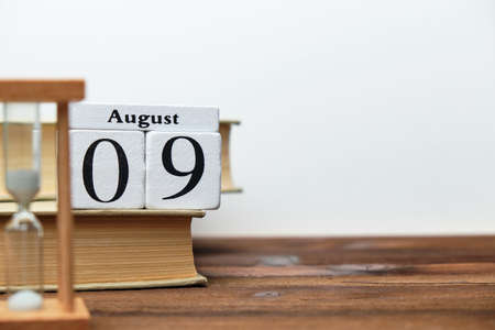 9th august - ninth day month calendar concept on wooden blocks with copy space.