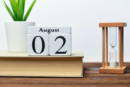 2nd august - second day month calendar concept on wooden blocks.