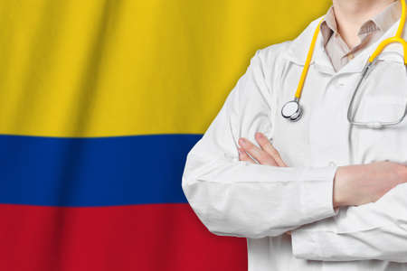 Republic of Colombia healthcare concept with doctor on flag background. Medical insurance, work or study in the country Banque d'images